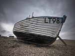 Old fishing boat on pebbled beach