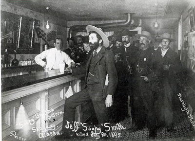 'Soapy' Smith's Saloon Bar at Skagway, Alaska, 1898 (b/w photo) by American Photographer - print