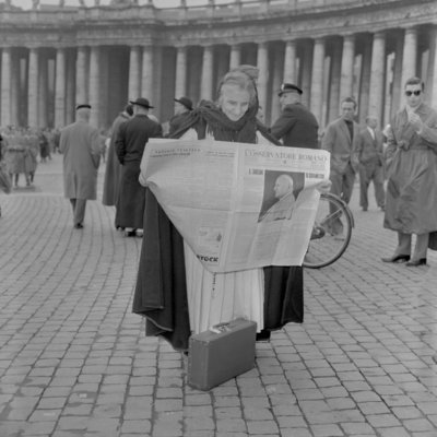 A woman reads the news of the election of Pope John XXIII, Vatican City, 4th November 1958 Poster Art Print by Anonymous