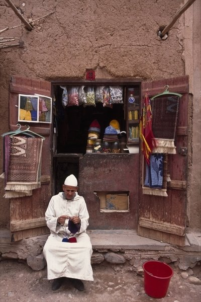 Fine Art Print of Vendor knitting, Taouit by Anonymous