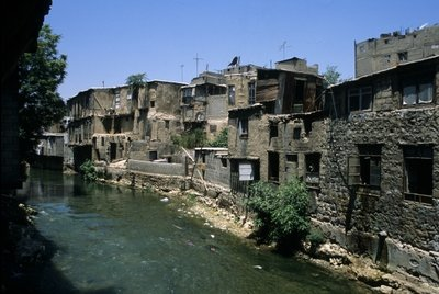 Old Houses along the Barada river in the Old City of Damascus Poster Art Print by Anonymous