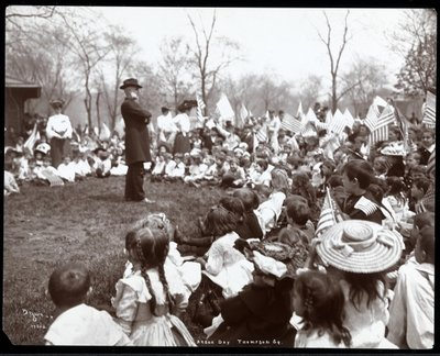 Children watching an entertainer on Arbor Day at Tompkins Square Park, New York, 1904 Poster Art Print by Byron Company