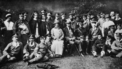 K. of K. plays the host: Lord Kitchener entertains a number of wounded soldiers at Broome Park, his seat near Canterbury, from 'The Illustrated War News' Poster Art Print by English Photographer