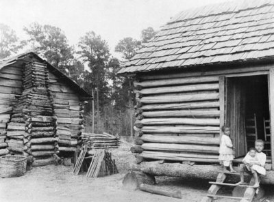 Log cabins in Thomasville, Florida, c.1900 (b/w photo) by American Photographer - print