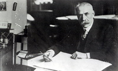 Sir Edward Elgar (1857-1934) at work on one of his orchestral scores (b/w photo) by English Photographer - print