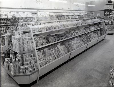 Confectionary aisle, Woolworths store, 1956 (b/w photo) by English Photographer - print