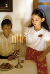 Children lighting the Hannukah lights Poster Art Print by Clive Uptton