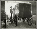A man spraypainting a delivery wagon of the Carolyn Laundry at 111 East 128th Street, East Harlem, New York, 1929 Poster Art Print by Byron Company