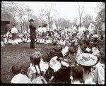 Children watching an entertainer on Arbor Day at Tompkins Square Park, New York, 1904