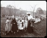 Children in a long line being lead by a woman on Arbor Day at Tompkins Square Park, New York, 1904 Poster Art Print by Byron Company