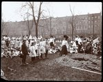 Adults and children holding flags standing around a newly dug hole for a tree planting on Arbor Day at Tompkins Square Park, New York, 1904 Poster Art Print by Byron Company