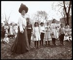 Woman with children holding flags on Arbor Day at Tompkins Square Park, New York, 1904 Poster Art Print by Byron Company