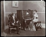 Man and woman playing a player piano, New York, 1907 Poster Art Print by Byron Company