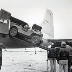 Unloading a jeep from Douglas 'Skymaster' at Shanghai airport, China, during the Second World War Poster Art Print by French School