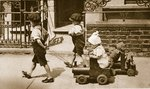 Children play on the street: boys pulling carts Poster Art Print by English Photographer
