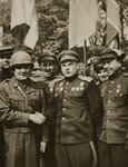 On 25th April 1945 the American First Army met the Soviet forces of Marshal Konev at Torgau, on the Elbe. Major General Reinhardt shakes hands with Marshal Konev Poster Art Print by English Photographer