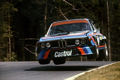 1974 Nurburgring, Germany. 14th July 1974 Hans Joachim Stuck takes off in the BMW 3.5 CSL he shared with Ronnie Peterson Poster Art Print by Anonymous