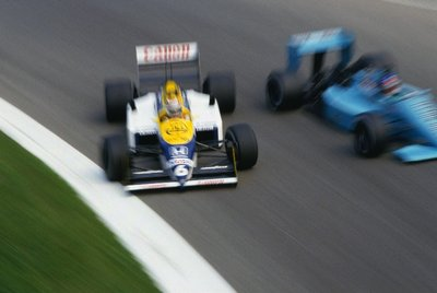 Fine Art Print of 1987 Italian Grand Prix. Monza, Italy. 4-6 September 1987. Nelson Piquet (Williams FW11B-Honda), 1st position, gets sideways as he passes Ivan Capelli (March 871-Ford) at the Parabolica. by Anonymous