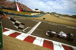 Fine Art Print of 1996 French Grand Prix. Magny-Cours, France. 28-30 June 1996. Damon Hill (Williams FW18 Renault) punches the air as he crosses the line to take victory. by Anonymous