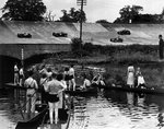 1938 August Bank Holiday, Brooklands. Boating up the River Wey to see the races Poster Art Print by English School