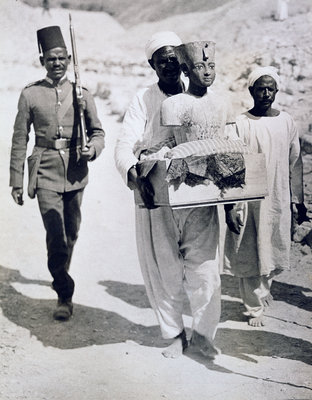 Mannequin or bust of Tutankhamun being carried from his tomb Poster Art Print by Harry Burton
