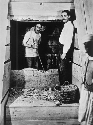 Howard Carter and a colleague excavating a tomb in the Valley of the Kings Poster Art Print by Harry Burton