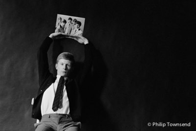 Andrew Loog-Oldham holding the Rolling Stones (small) by Philip Townsend - art