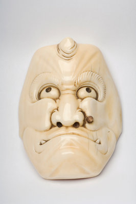 Carved ivory okimono in the shape of a face by Unknown - print