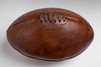 A lace-up leather rugby ball by Mark Cross Co. of Walsall by unknown - print