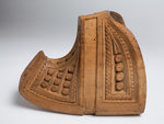 Decoratively carved wooden stirrup with an upturned toe by unknown - print