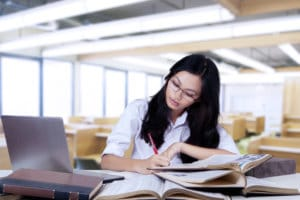 Woman studying - When to Take the MCAT