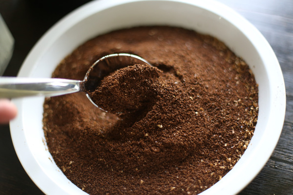 plate of ground coffee with spoon