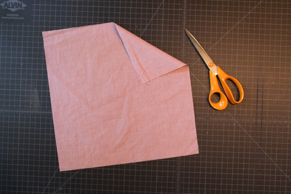 cut pocket square laying on table