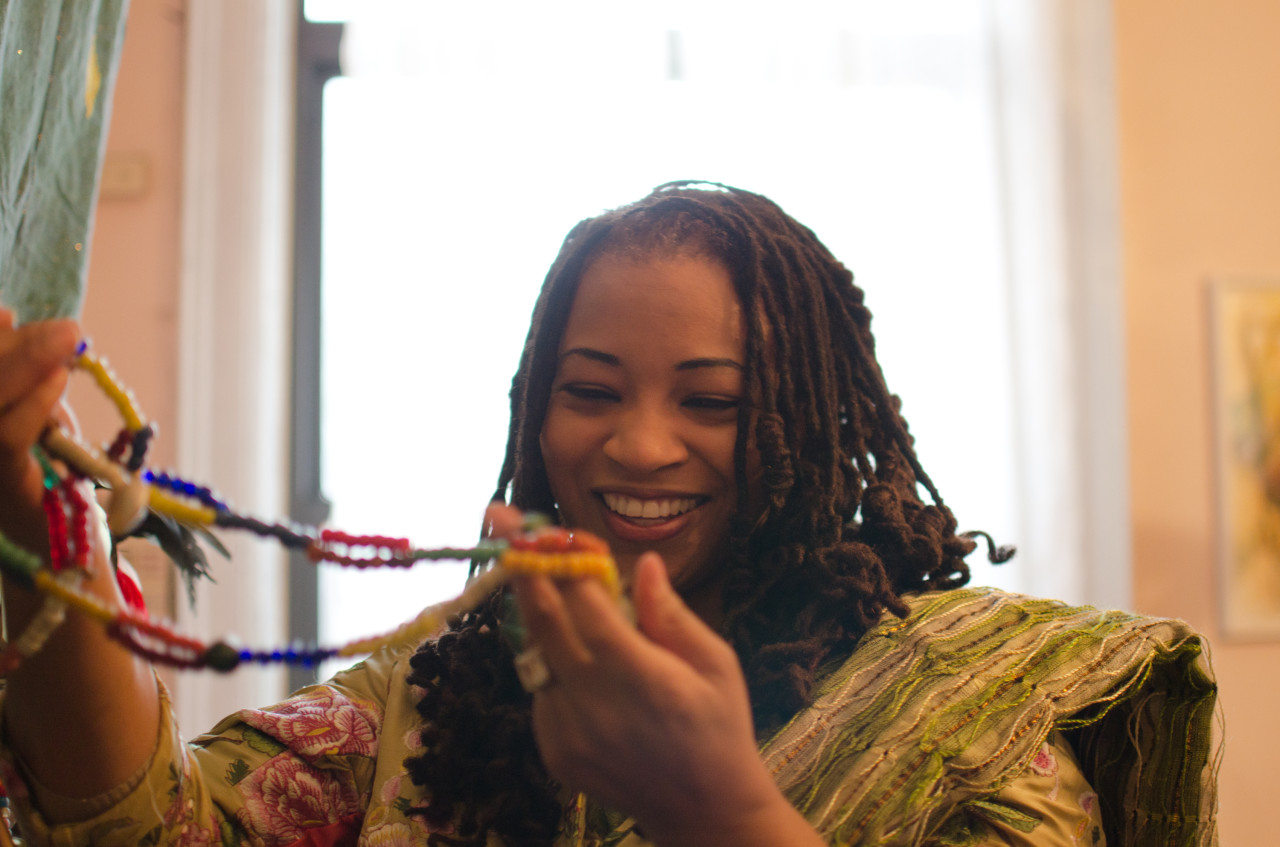 Dowoti Desir shows her Vodou beads