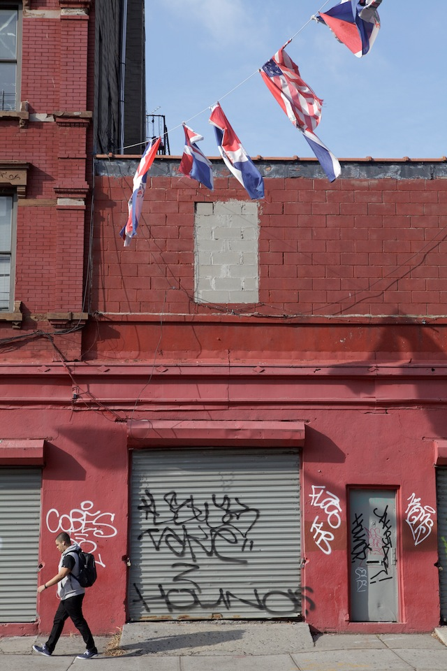 Dominican and American flags stretch across a street in South Williamsburg (Photo by Marisa Wong)