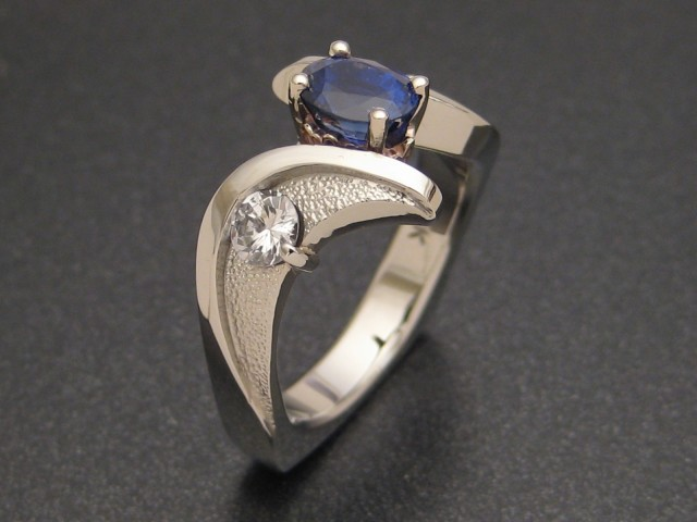 Although shipping the groom's grandmother's heirloom diamonds cross-country delayed work on this sapphire wedding ring, Sculpted Jewelry Designs at CustomMade.com still completed this ring in time for a surprise proposal.