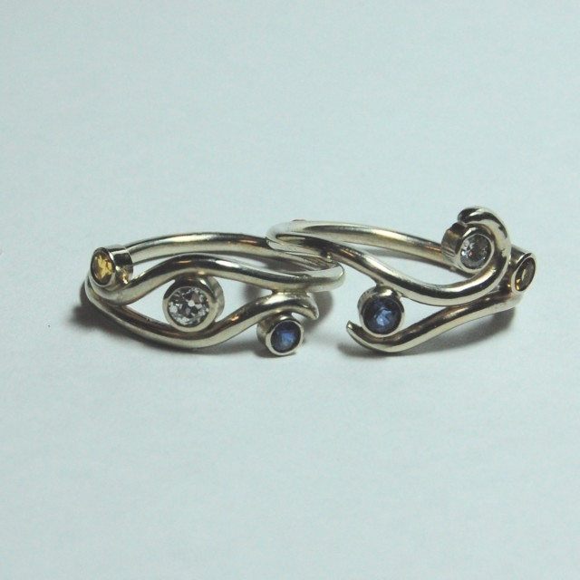 "The ""For Maya"" wedding ring set has engagement and wedding rings that can be worn separately or combined into ""one funky ring."" e. scott originals at CustomMade.com"