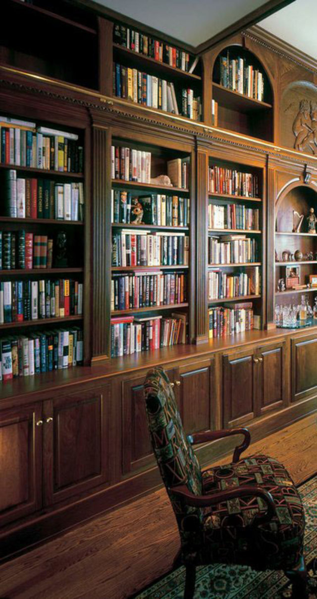 Walnut Library with Ladder evokes the feeling that Rhiannon describes in old Russian traditional apartments with floor-to-ceiling bookshelves. Built by Odhner & Odhner Fine Woodworking Inc. on CustomMade.com