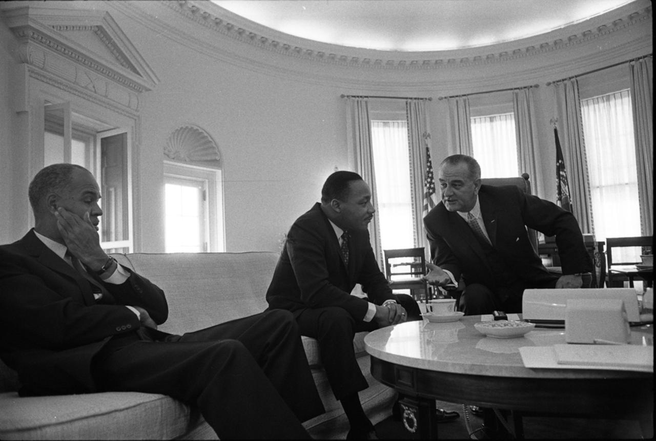 President Johnson meets with Martin Luther King, Roy Wilkins, and other civil rights activists in the Oval Office, January 18, 1964. (White House photo by Yoichi Okamoto, via LBJ Library)
