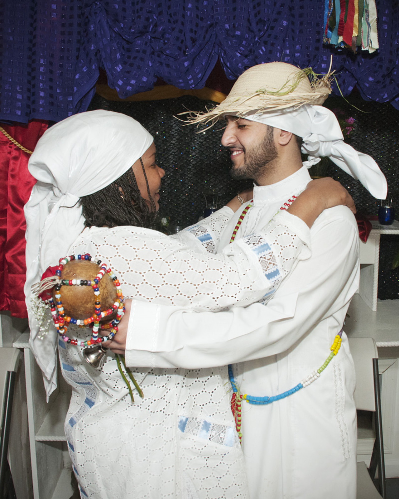 After Oungan Ahmed completes his initiation, his spiritual mom, Supote Bon Mambo, greets him for the first time as her spiritual son (Photo courtesy Shannon Taggart)