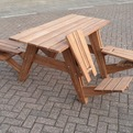 A-picnic-table-that-transforms-into-four-lounge-chairs-s