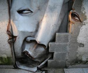 Artist-paints-distorted-faces-throughout-streets-of-brazil-m