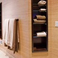 Bathroom-towel-niches-of-macassar-ebony-with-glas-shelves-s