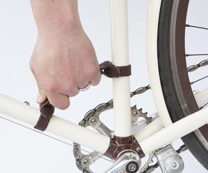 Bicycle Frame Handle Makes Carrying A Bike Easy
