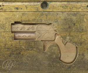 Bullet-proof-carvings-on-school-desks-by-ben-turnbull-m