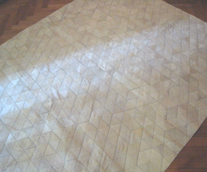 Cowhide Patchwork Rug in White Triangles