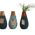 Drop-shaped-vase-made-from-recycled-paper-and-offcut-wood-s
