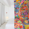 French-artist-covers-half-of-a-hotel-room-in-graffiti-s