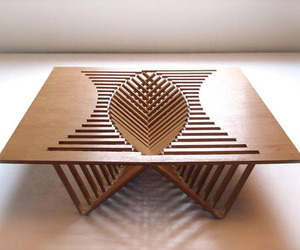Furniture-with-a-figuratively-beating-heart-rising-table-m