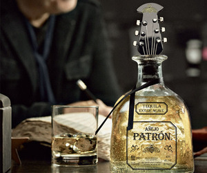 Guitar-stopper-bottle-of-patron-tequila-m